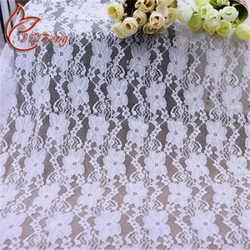 热销锦氨小梅花蕾丝面料 婚纱蕾丝 弹力蕾丝布料服装蕾丝花边面料